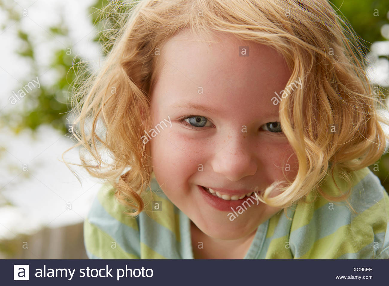 Low angle close up portrait of cute girl - Stock Image