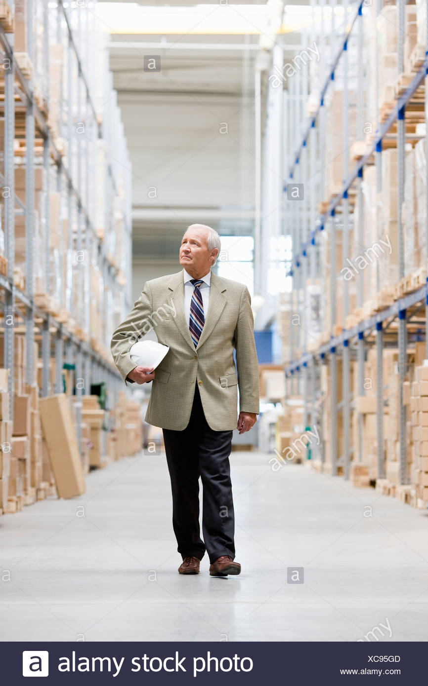 man in charge in storage Stock Photo