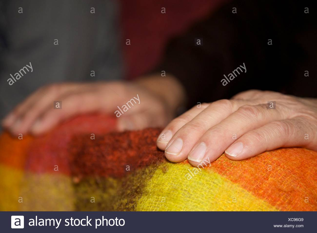 Cropped Image Of Man Hand On Duvet - Stock Image