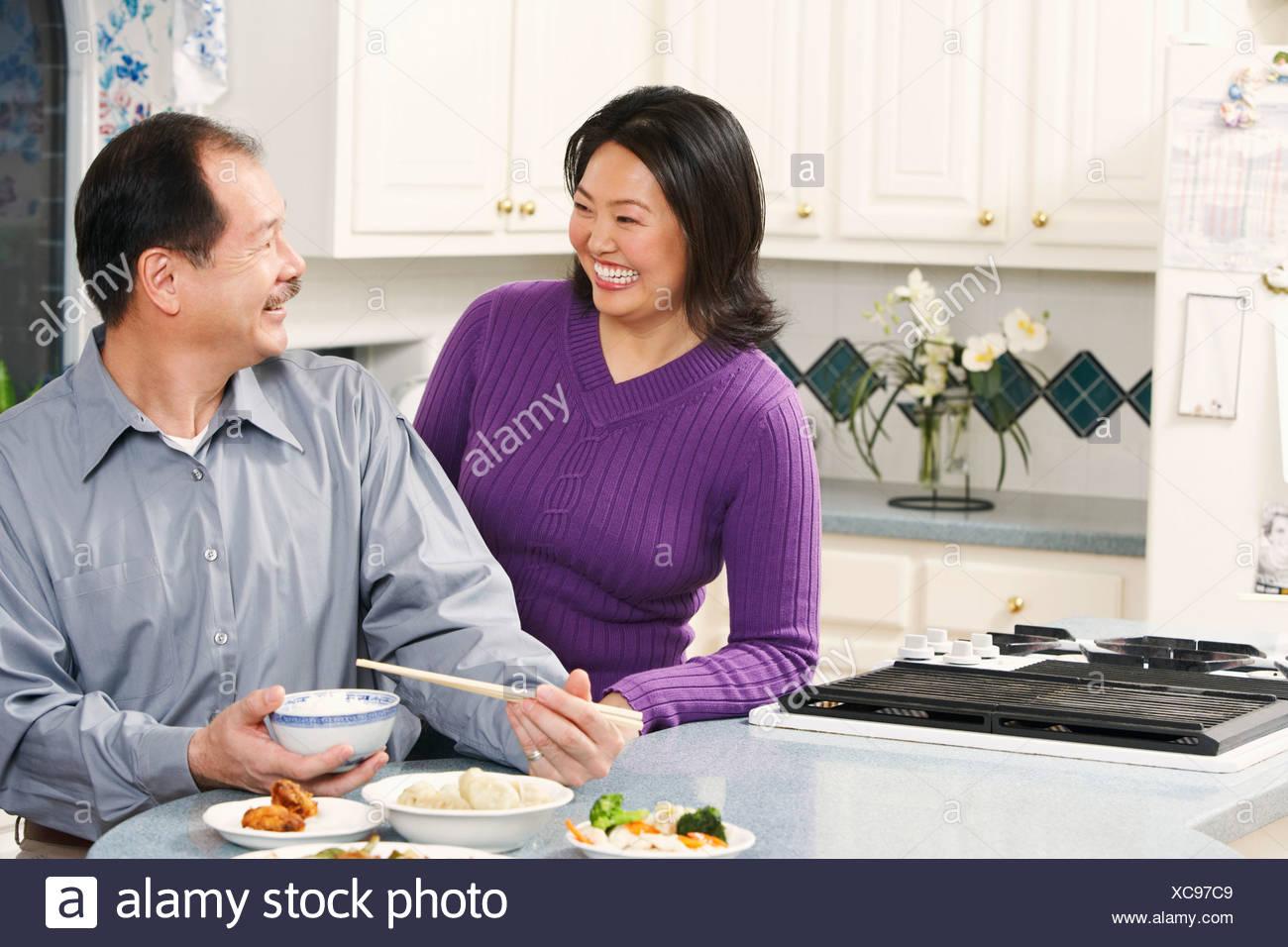 Close-up of a senior man looking at a mature woman - Stock Image