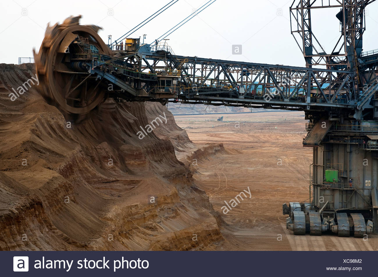 Bucket-wheel excavator on the slope of the open pit, Grevenbroich, North Rhine-Westphalia, Germany, Europe - Stock Image