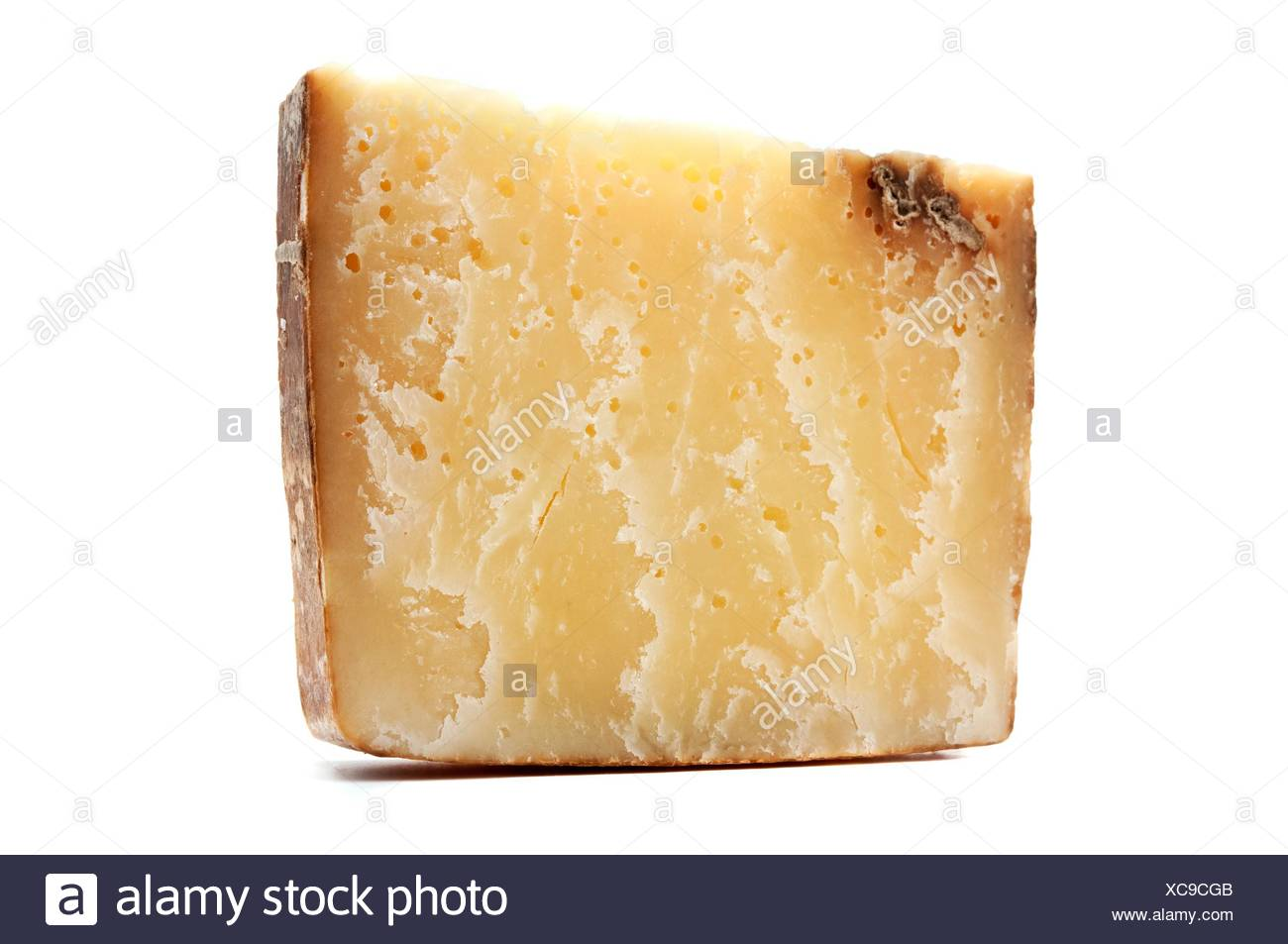 Bagoss cheese on a white background. - Stock Image