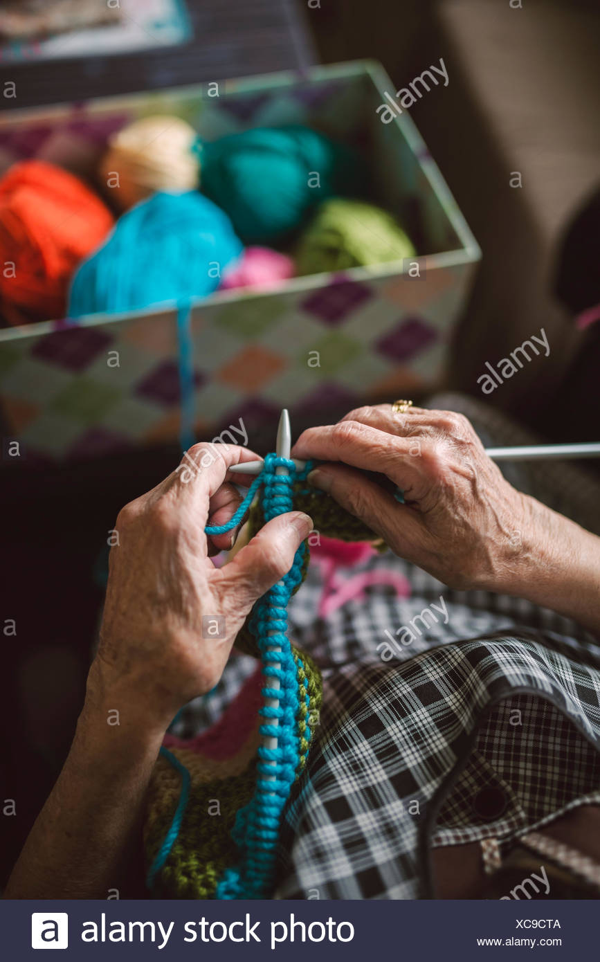 Hands of knitting senior woman, close-up - Stock Image