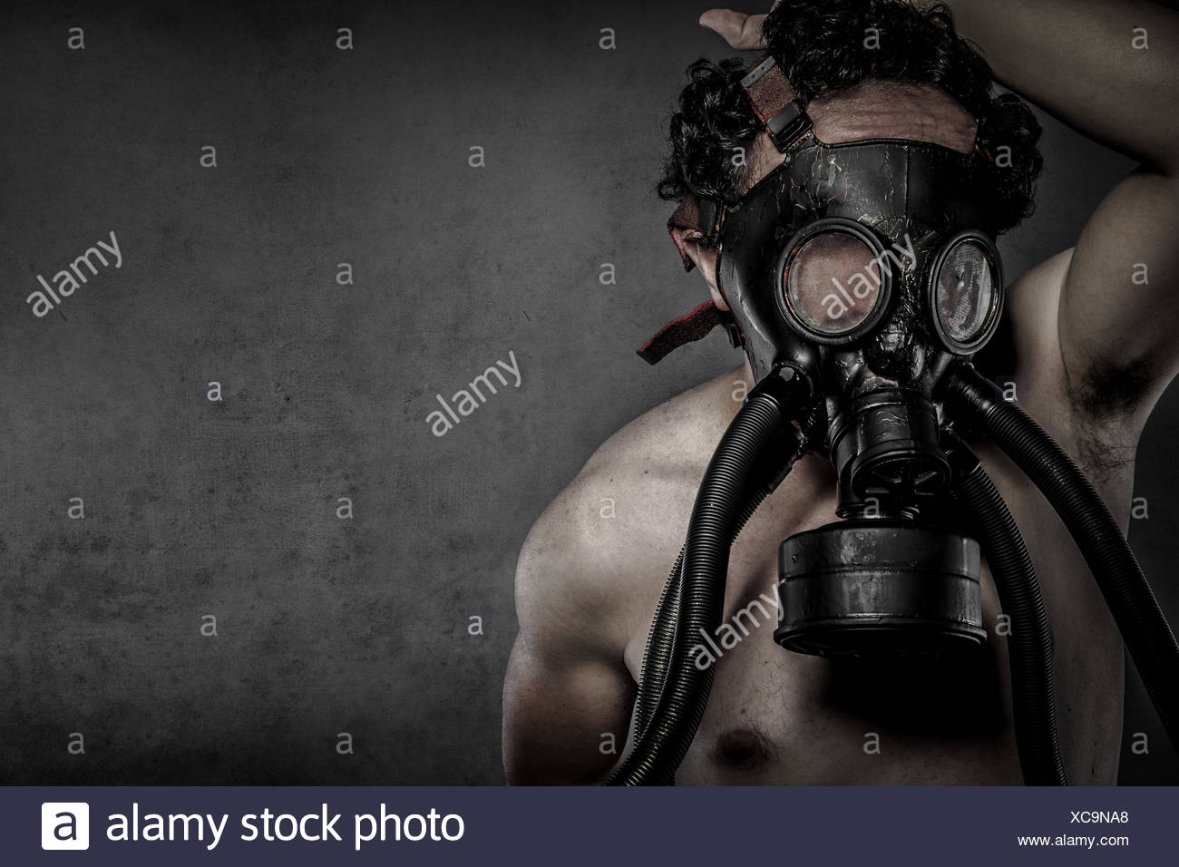 Pollution, nuclear disaster, man with gas mask, protection Stock Photo