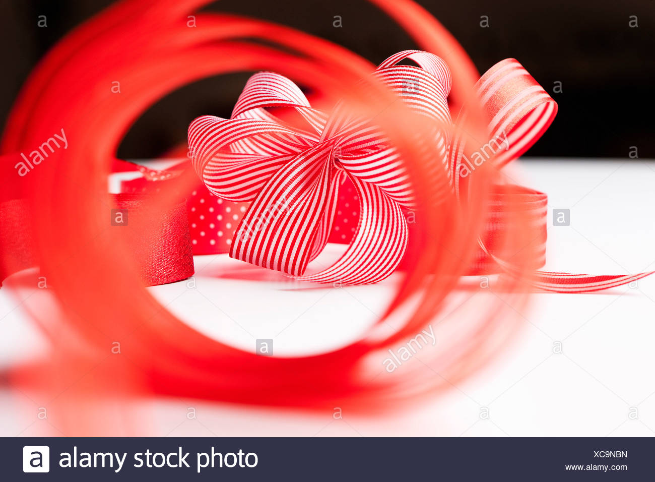 Close up of decorative red ribbons - Stock Image