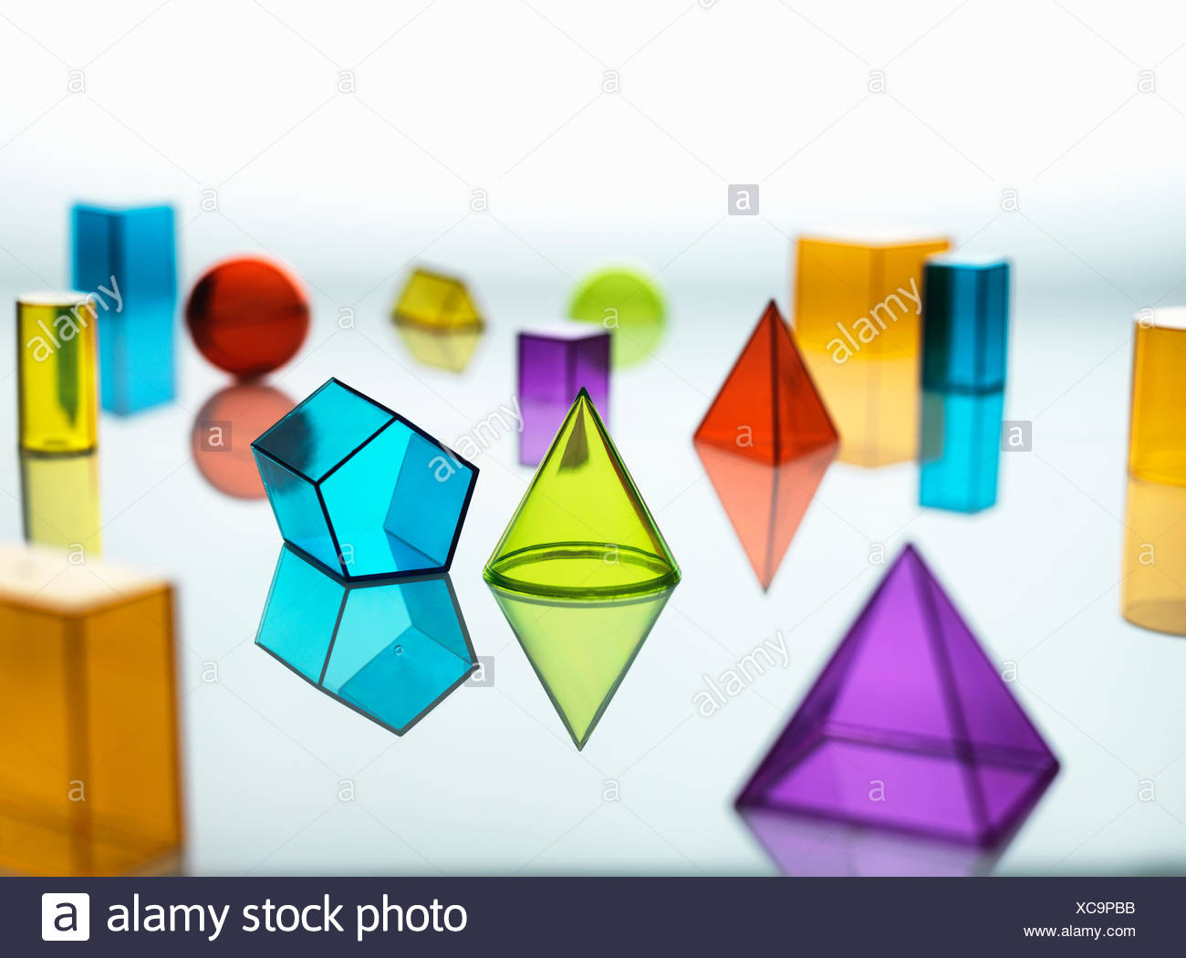 Large group of various multi colored geometric shapes - Stock Image