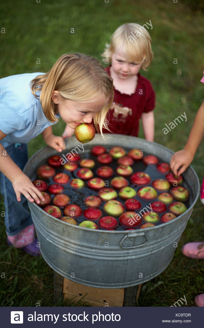 Children apple bobbing - Stock Image