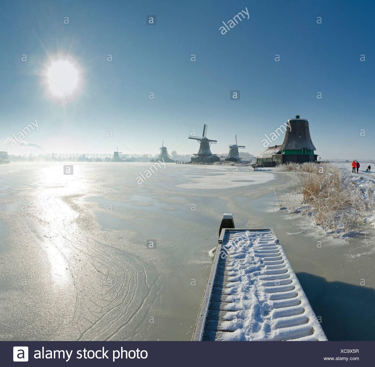 Netherlands, Holland, Europe, Zaandam, North Holland, windmill, water, winter, snow, ice, Windmills, frozen, river, Zaan - Stock Image