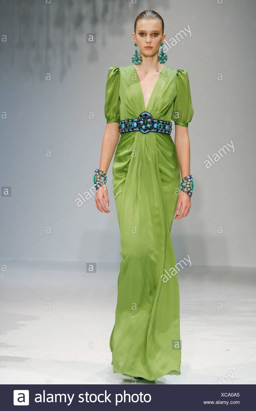b2715069e949 Andrew Gn Paris Ready to Wear Spring Summer Model wearing a green low cut  flolength gather detail dress blue and green beaded