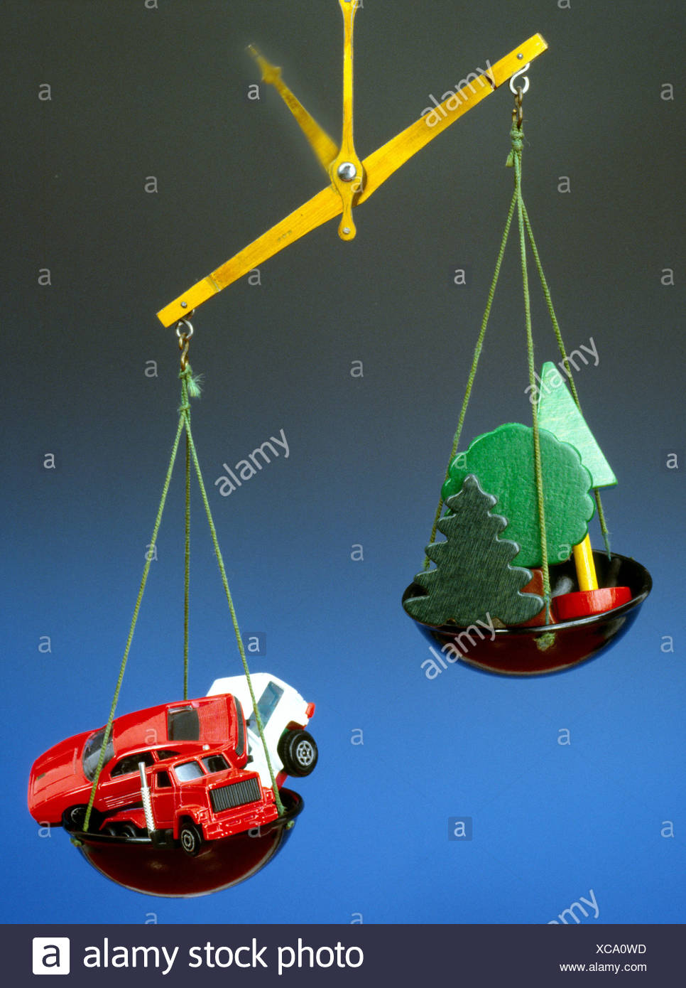 car automobile grass nature plant still life environment environment protection imbalance scales Stock Photo