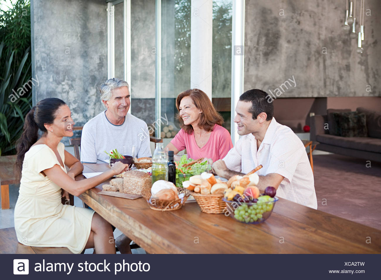 Adult family members at table outdoors - Stock Image