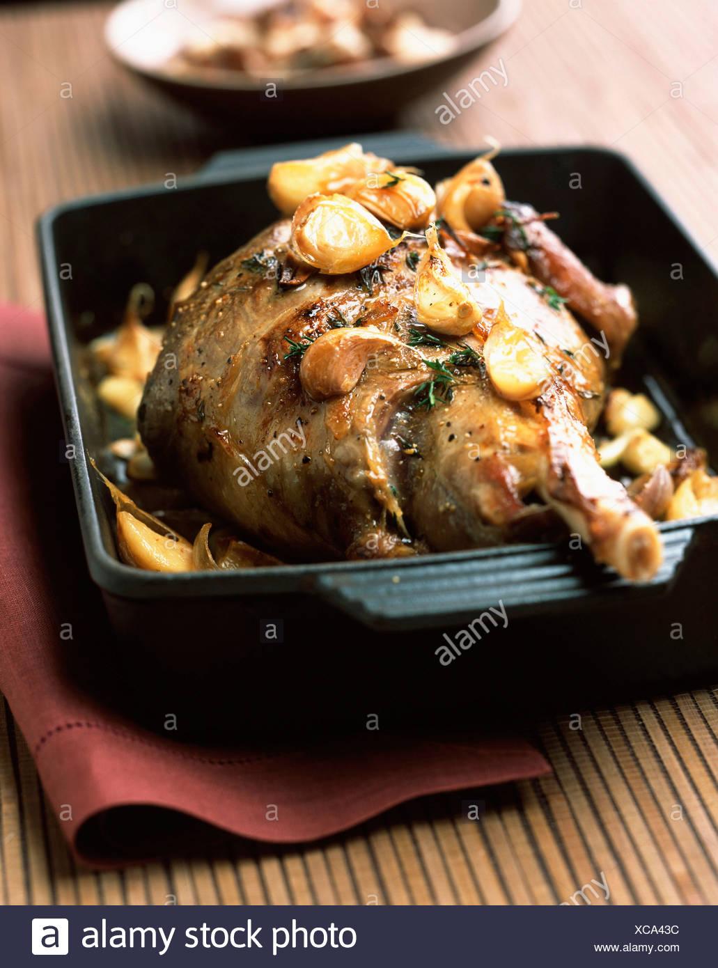 leg of lamb with 40 cloves of garlic - Stock Image