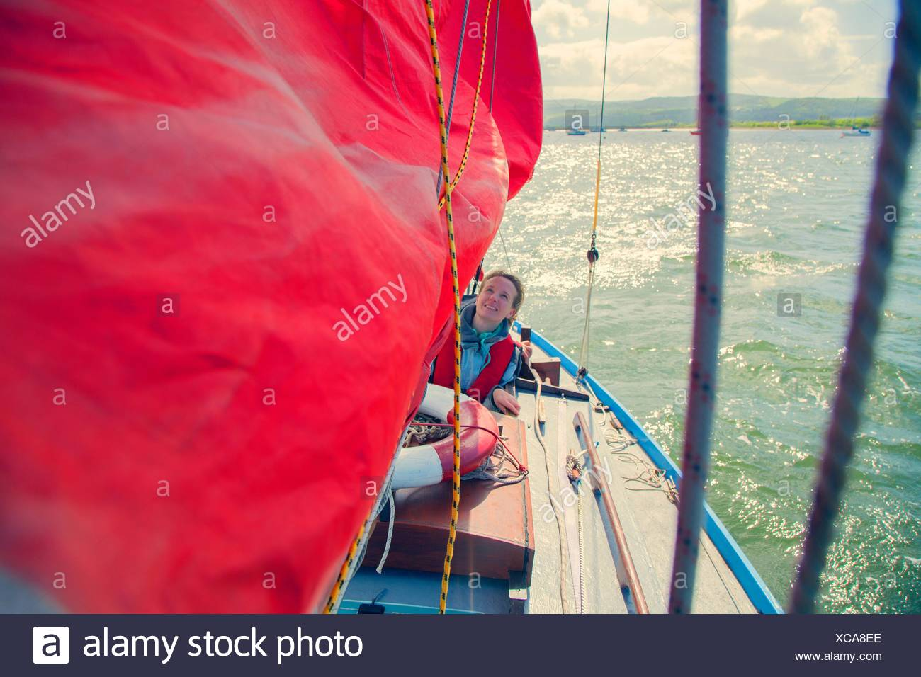 Mid adult woman on sailing boat Stock Photo