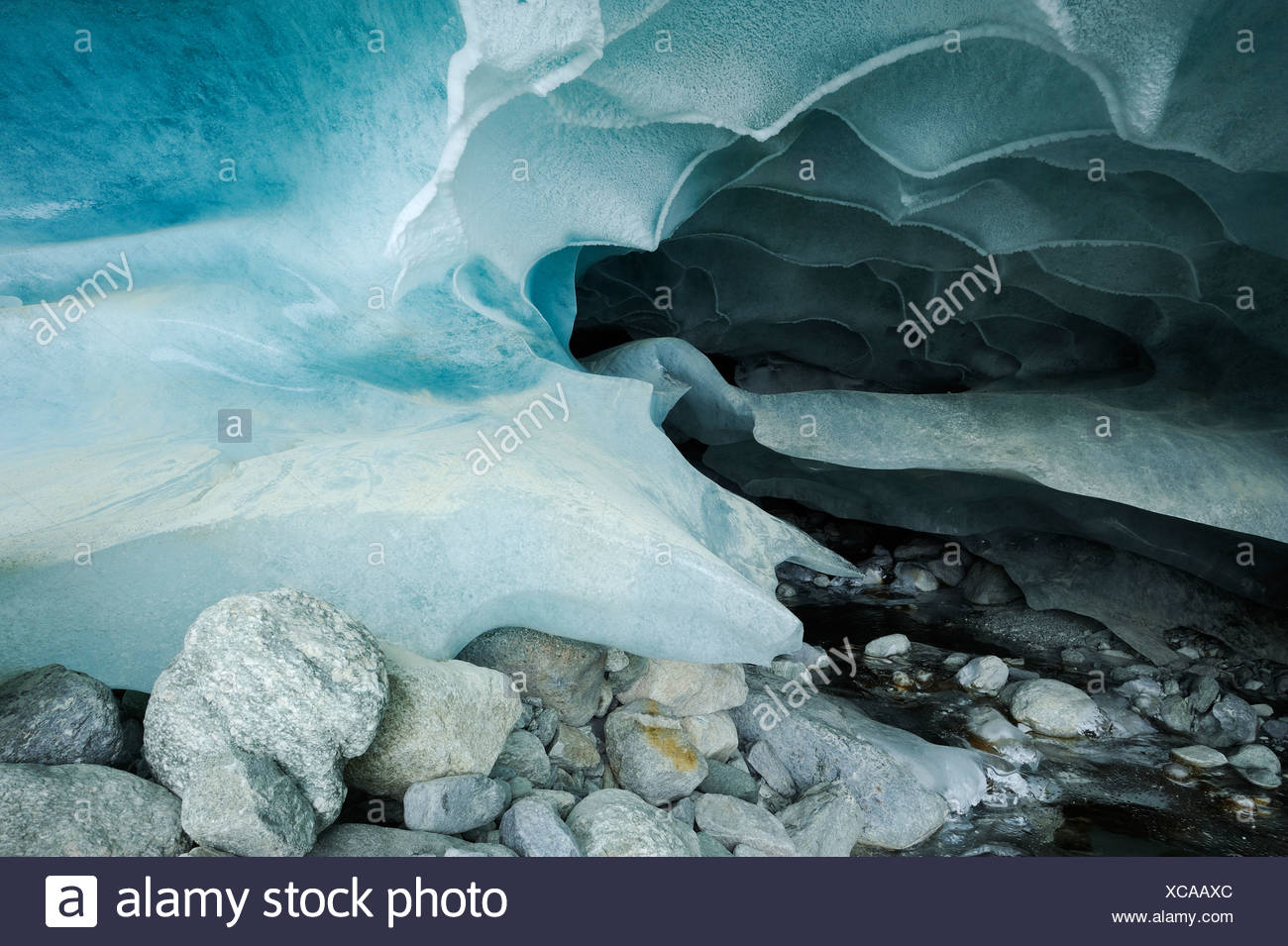 Natural ice cave in the Zinal Glacier, Zinal, Valais, Switzerland, Europe - Stock Image