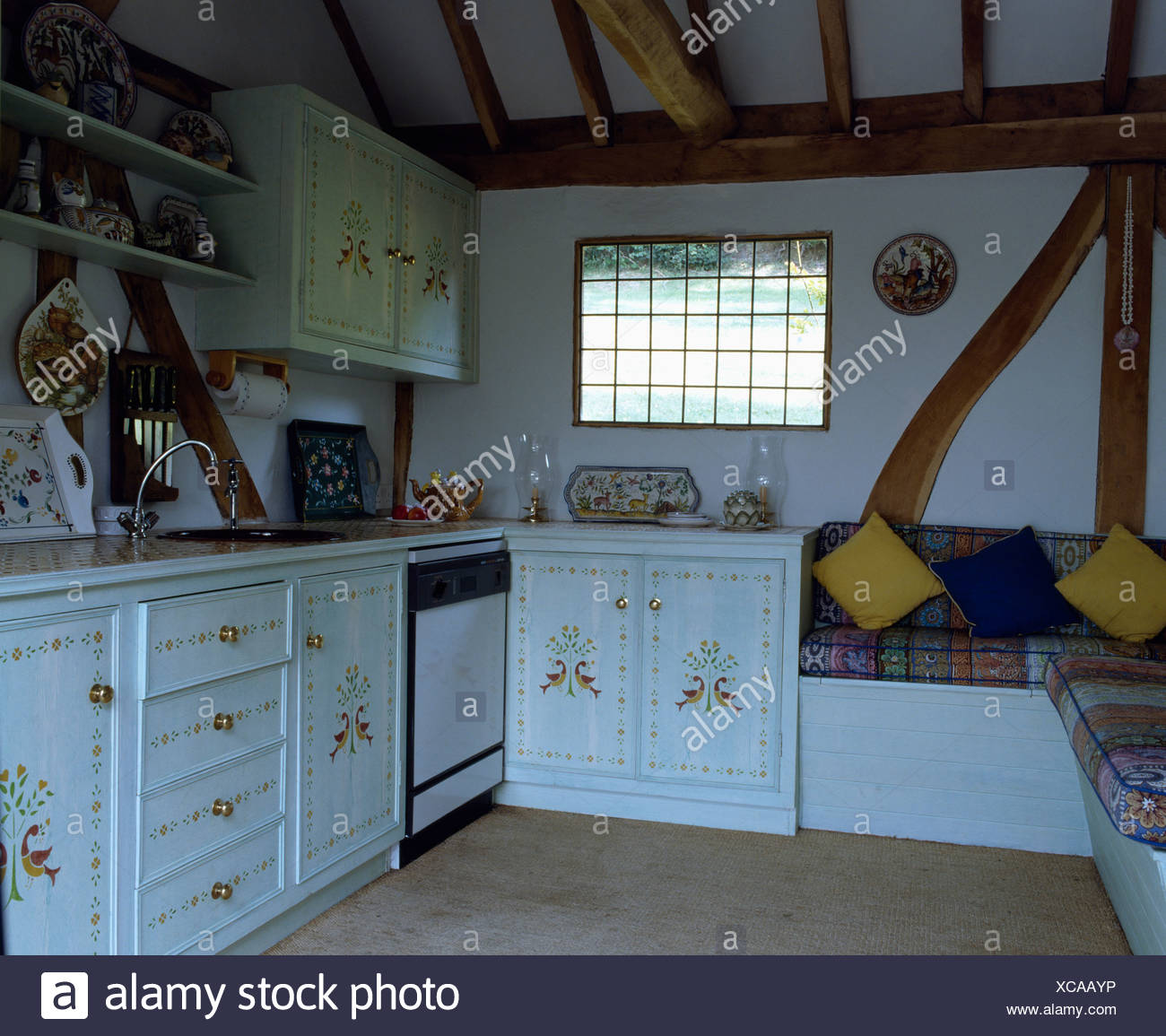 White cottage kitchen with stencilled cupboard doors Stock Photo ...
