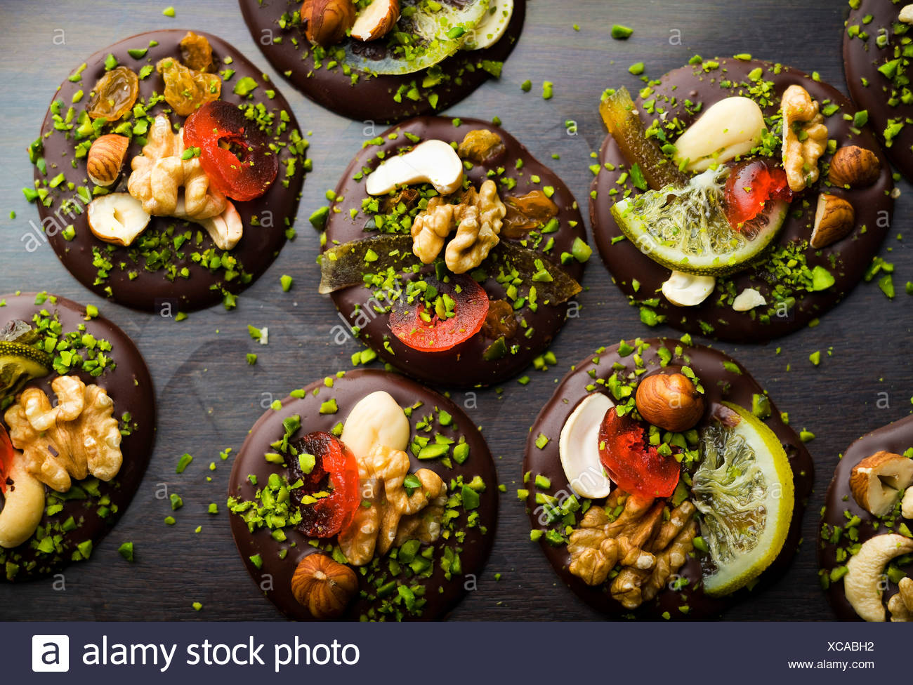 Chocolate and dried fruit Mendiants - Stock Image