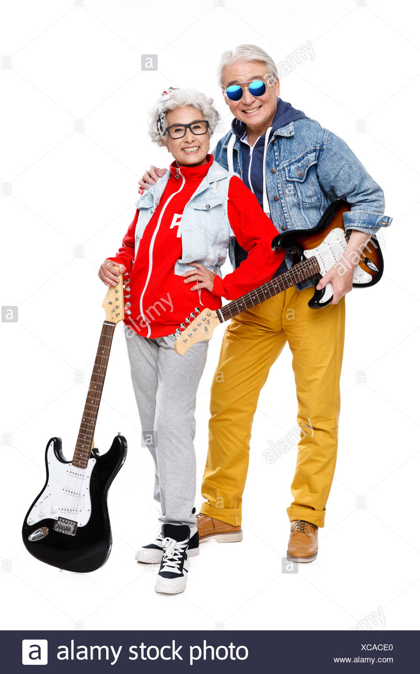 Two fashion elderly couples with a guitar to pose - Stock Image