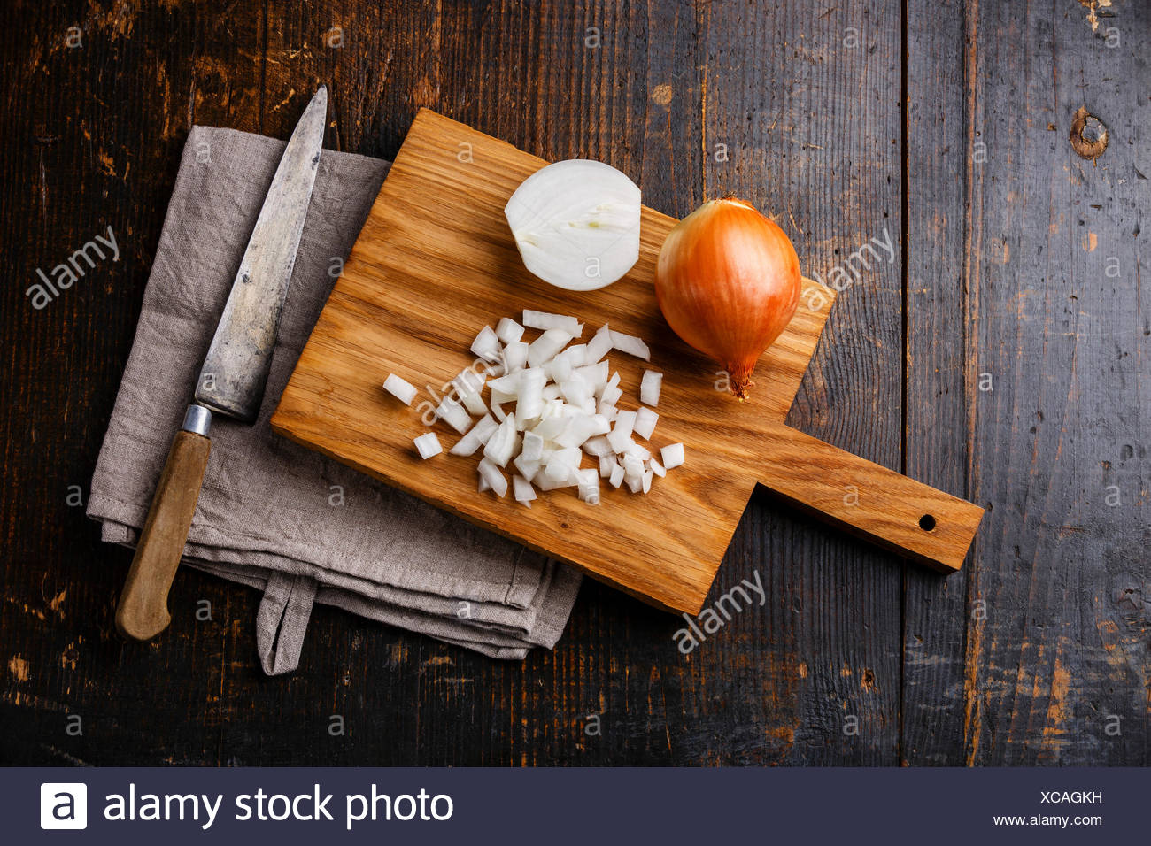 Chopped Onion On Wooden Cutting Board And Kitchen Knife