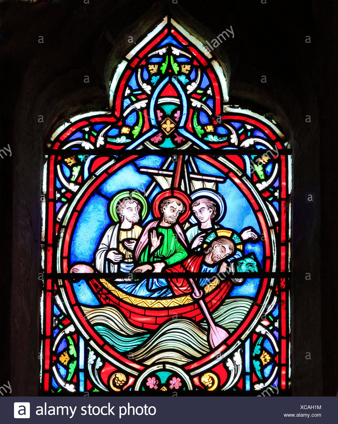 Scene from Life of Jesus, by Adolph Didron, Paris, 1860, stained glass window, Feltwell, Norfolk. Jesus sleeps in boat before storm - Stock Image