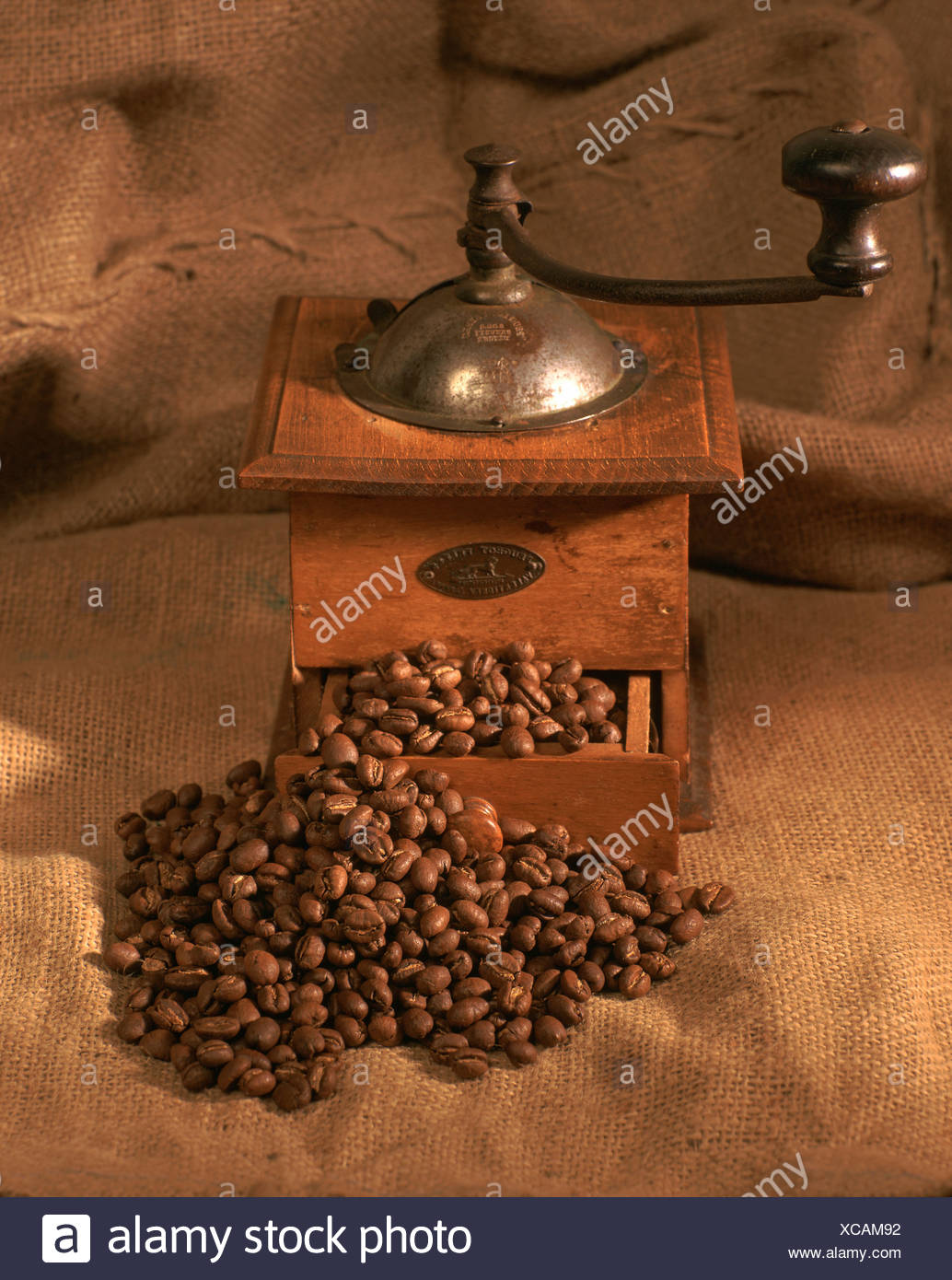 Coffee mill coffee beans on a gunny - Stock Image