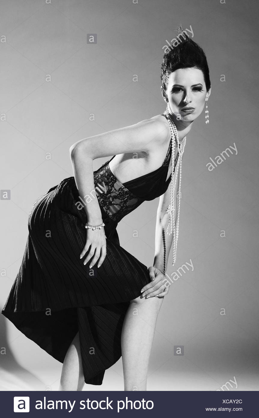 Woman, young, dark-haired, dress, pose, b/w, , - Stock Image