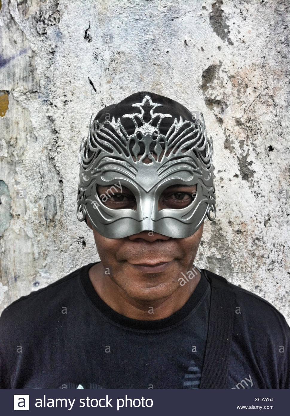 Man wearing mask at carnival, Rio de Janeiro, Brazil - Stock Image