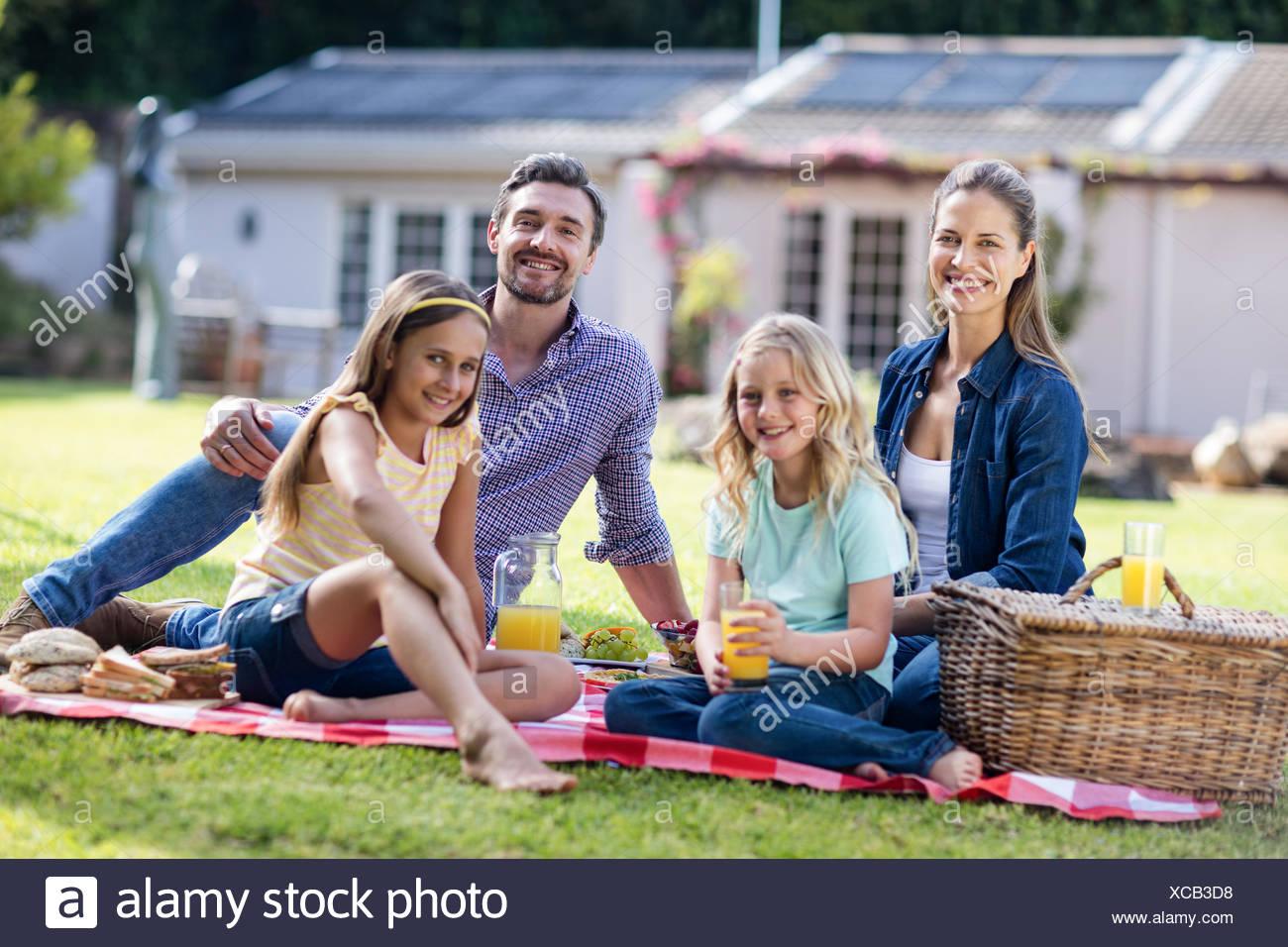 Happy family having a picnic - Stock Image
