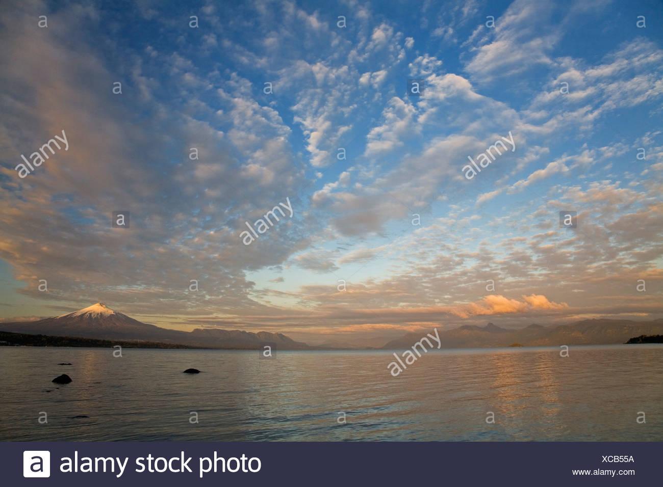 Sunset at Vulcano Villarrica at the lake Lago Villarrica Chile, South America - Stock Image
