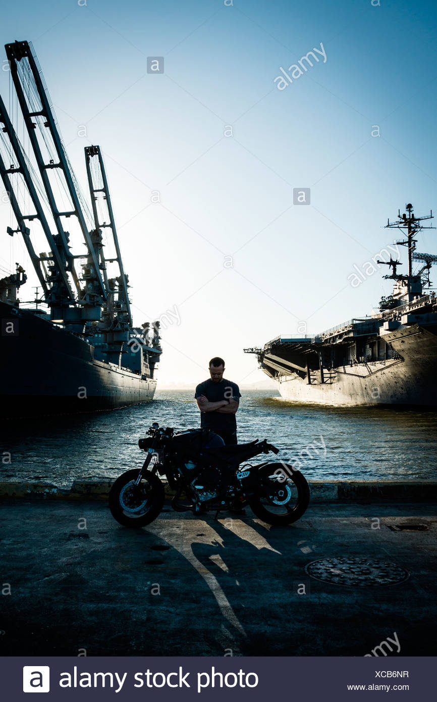Motorcyclist at the Docks - Stock Image