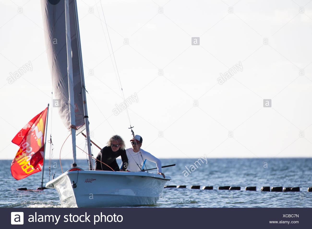 sailing boats, docking manoeuvre - Stock Image