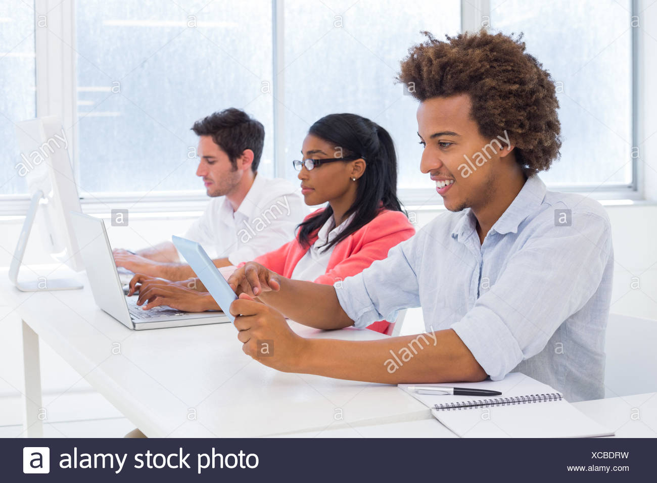 Business people hard at work - Stock Image