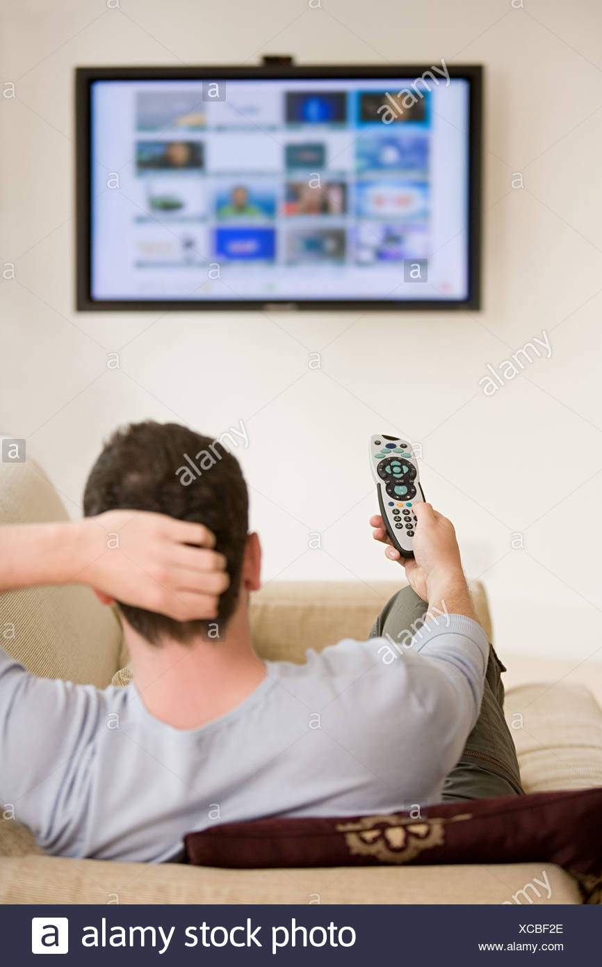 Man watching television - Stock Image
