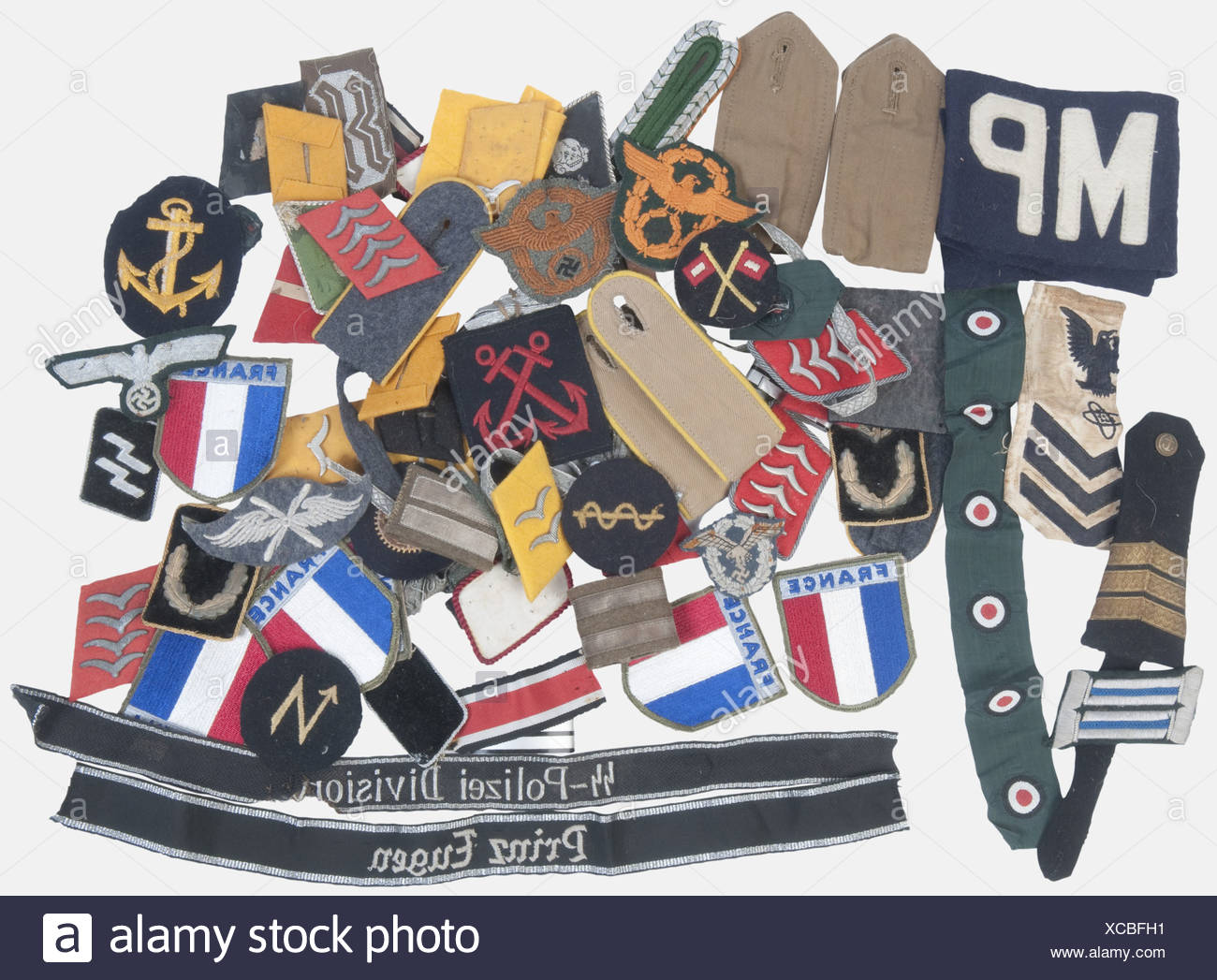 A big lot of various German Army cloth insignia., About 65 items, including sidecap cockades of the coastal artillery and various sleeve badges. We add repro Waffen SS cufftitles, French and US cloth insignia. historic, historical, 1930s, 1930s, 20th century, Wehrmacht, armed forces, army, NS, National Socialism, Nazism, Third Reich, German Reich, Germany, object, objects, stills, clipping, clippings, cut out, cut-out, cut-outs, utensil, piece of equipment, utensils, Additional-Rights-Clearances-NA - Stock Image