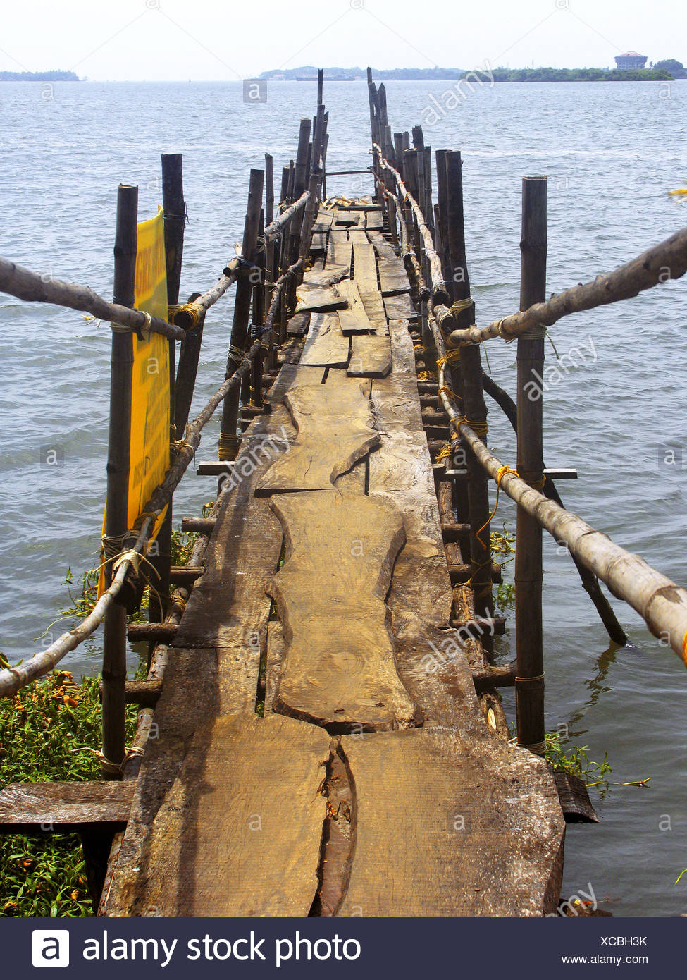 A wooden Landing stage (bridge) for Ferryboats leading towards a Dock. Ernakulam (Cochin) Kerala, India. - Stock Image