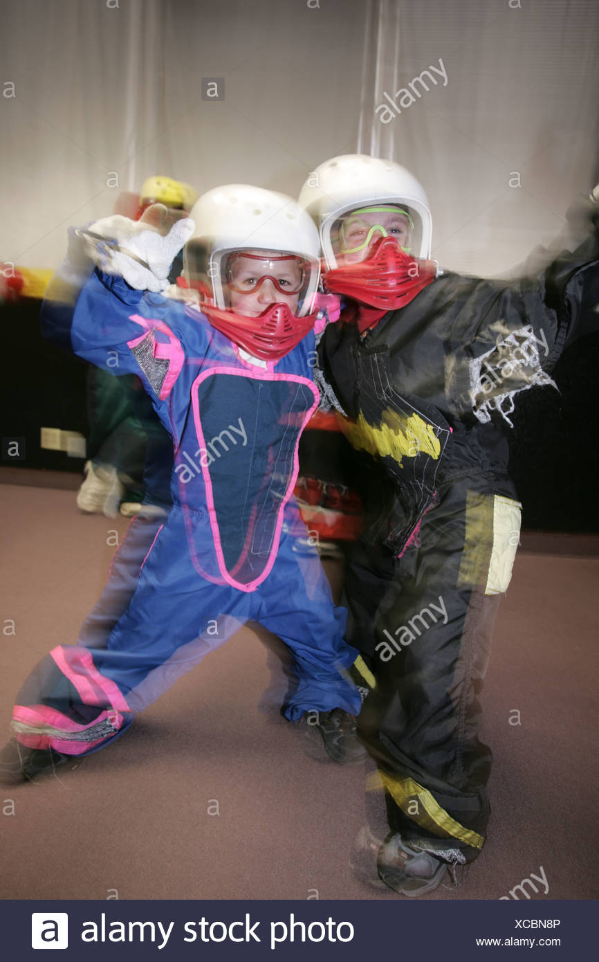 Two young participants ready for an indoor skydiving flight