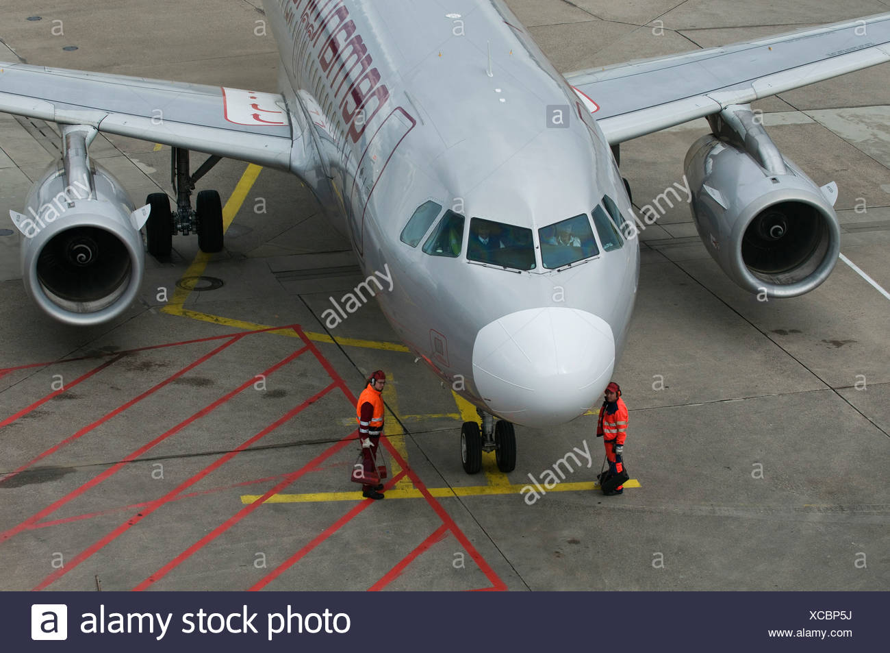 Germanwings aircraft, finishing touches prior to take-off, apron workers at the machine, Cologne Bonn Airport, also called - Stock Image
