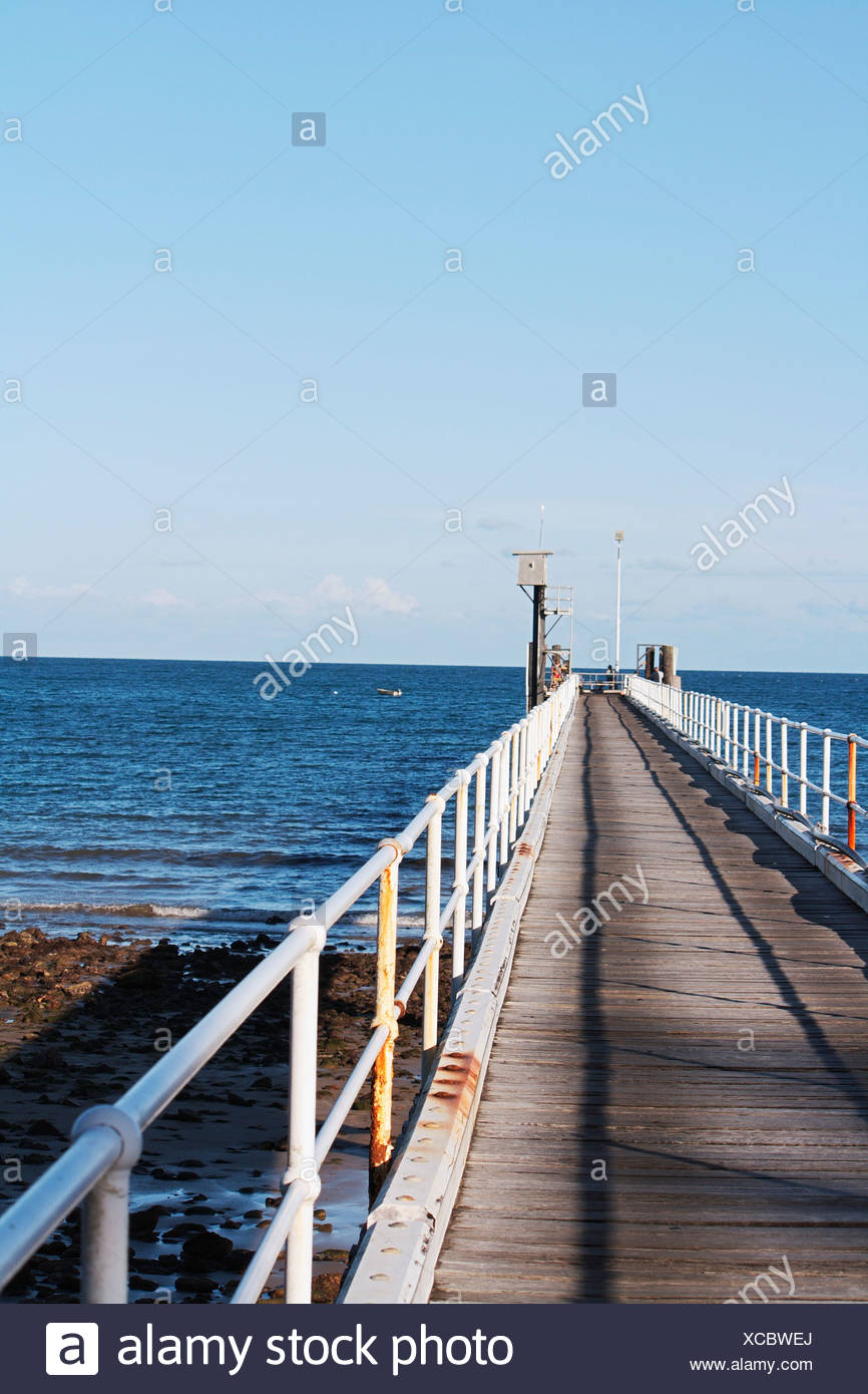 Australia, Queensland, Clump Point, View of jetty at seaside - Stock Image