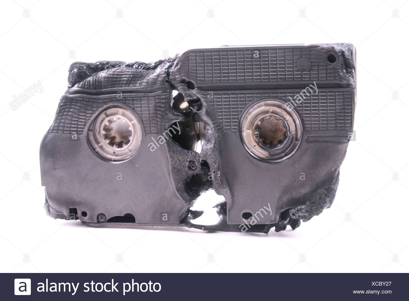 Burning Video cassette - Stock Image