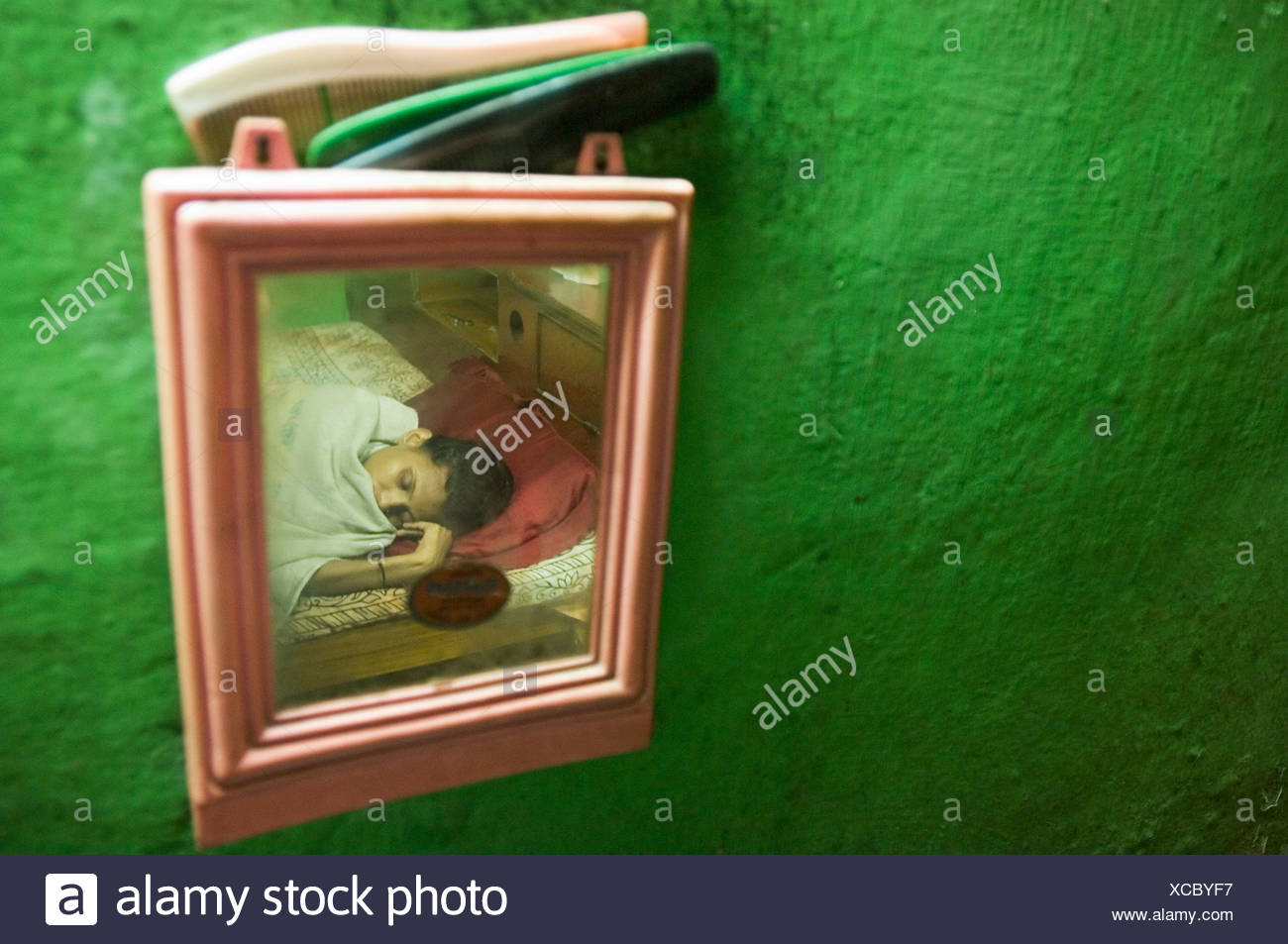 Khusbun Nessa, tuberculosis patient lying sick in her bed at home while her family cares for her, Howrah, Hooghly, West Bengal, Stock Photo