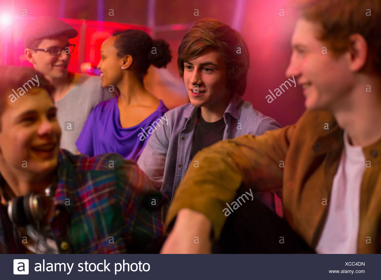 Group of friends sitting at party - Stock Image
