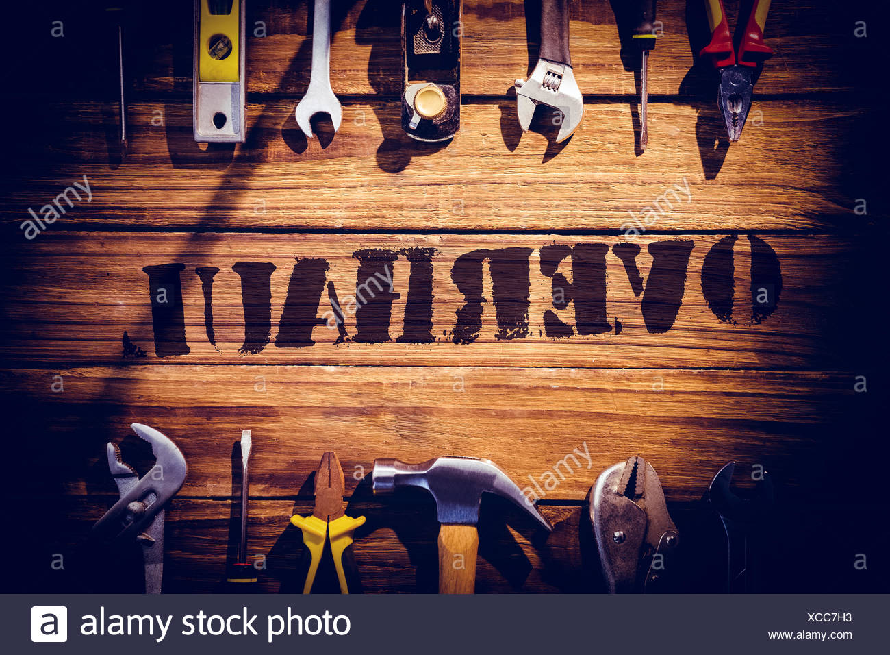 Overhaul against desk with tools Stock Photo