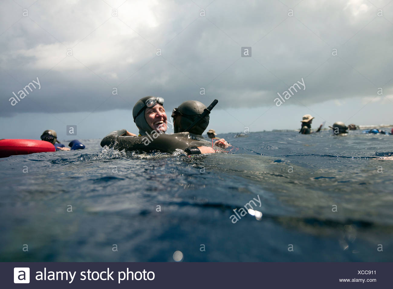 Erin Magee celebrates at the surface after completing her sixth USA national record with a constant weight dive to 81 meters. - Stock Image