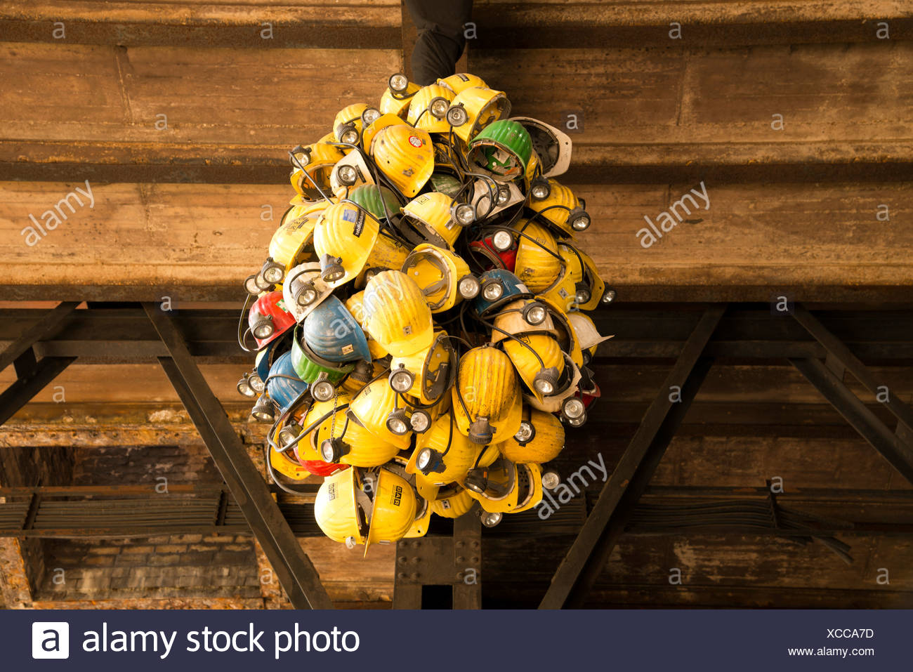 Working clothes equipment construction helmets mining mine occupation profession clothes Germany Duisburg former Europe yellow Stock Photo