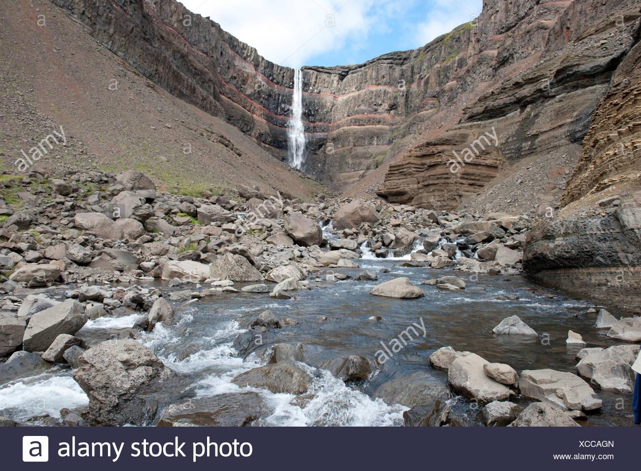 Rugged landscape, stream, Hengifoss waterfall near Egilsstaðir, Iceland, Scandinavia, Northern Europe, Europe - Stock Image