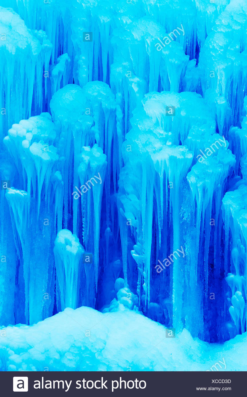 Frozen waterfall with icicles - Stock Image