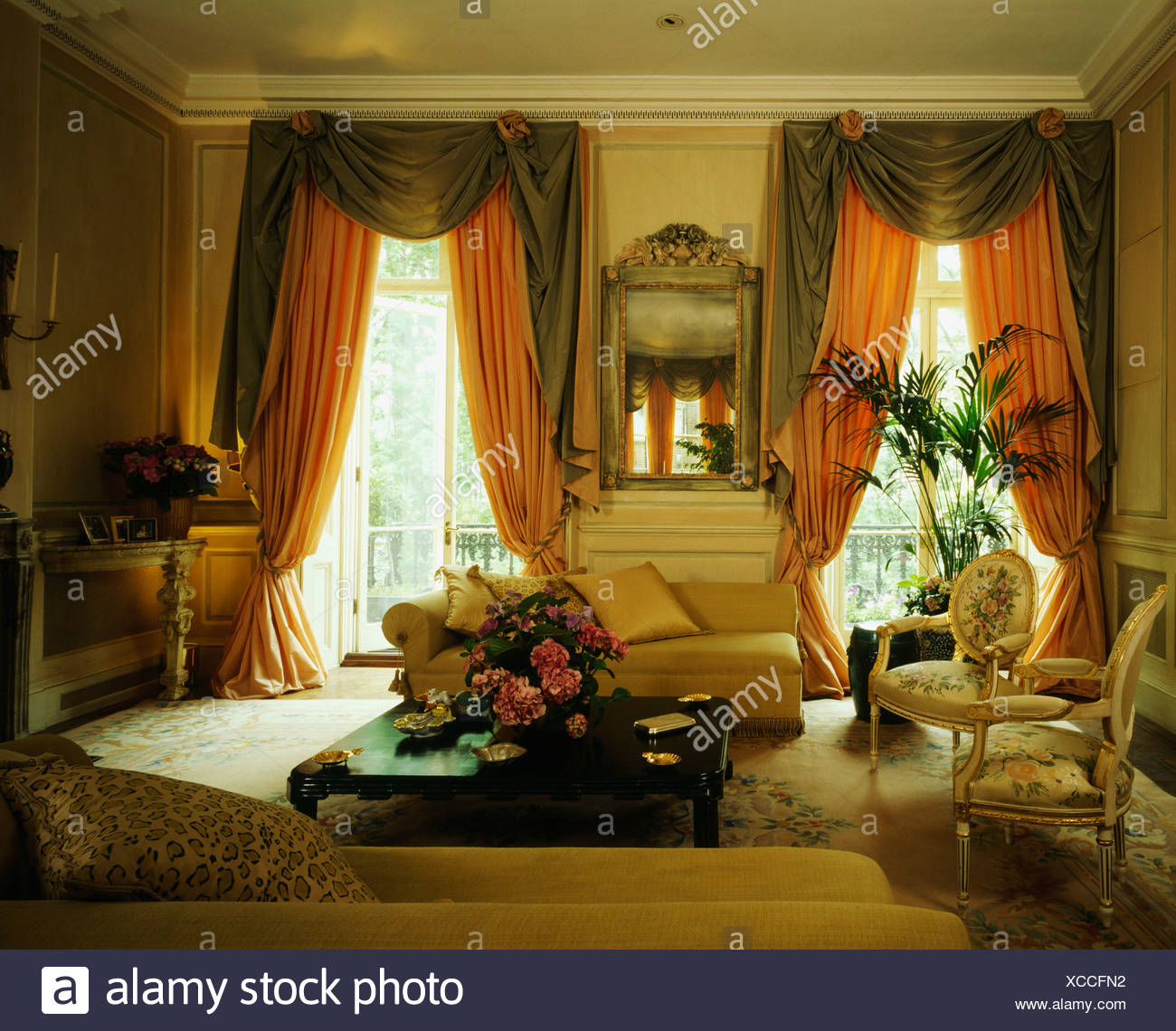 Peach Silk Drapes With Brown Tails And Swags At Tall Windows