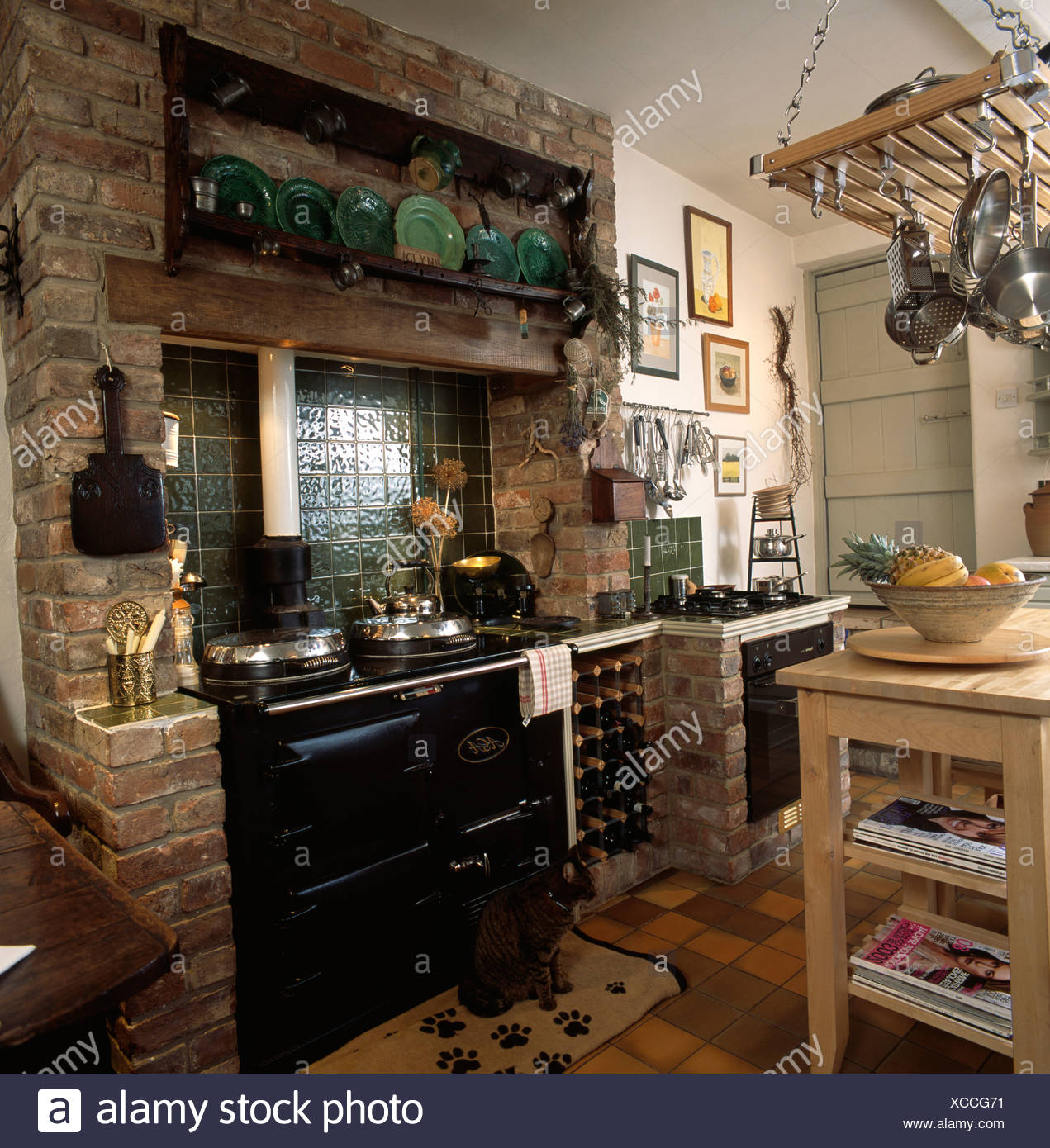 Wine Storage Rack Beside Black Aga In Exposed Brick Fireplace