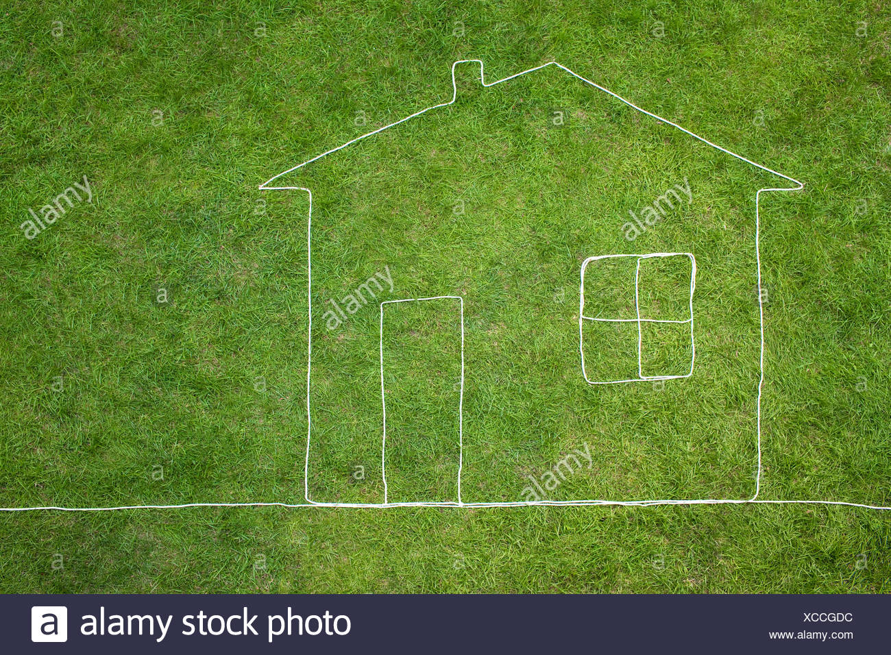 House on meadow - Stock Image