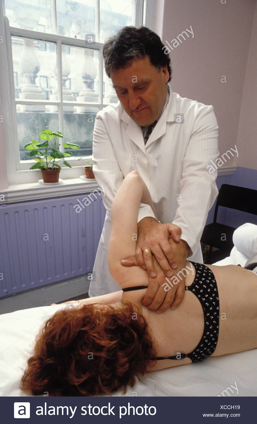 Osteopath working with woman London School of Osteopathy UK Stock