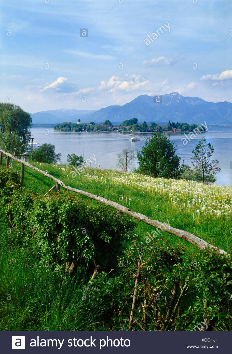 The Island Fraueninsel, Chiemsee lake in front of the Hochgern Mountain, Chiemgau, Upper Bavaria, Bavaria, Germany, Europe Stock Photo